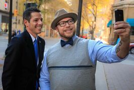 Mayor-elect Brian Bowman poses for a selfie with Luke Nolan Thursday morning in the Exchange District.