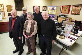 CJNU production crew stand next to radio board set up in the Shriner's Temple where they are broadcasting for the month of March to raise funds for the Shriners. From left - Bill Stewart (red), Tom Dercola (hat), Lee Major (rear), Ernie Nairn (right) and Susan Hamilton.   March 18, 2015.
