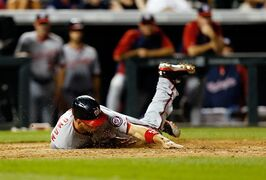 Washington Nationals' Ryan Zimmerman scores during the seventh inning of a baseball game against the Colorado Rockies on Monday, July 21, 2014, in Denver. (AP Photo/Jack Dempsey)