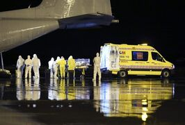In this photo provided by the Spanish Defense Ministry, aid workers and doctors transfer Manuel Garcia Viejo, a Spanish priest who was diagnosed with the Ebola virus while working in Sierra Leone, from a military plane to an ambulance as he leaves the Torrejon de Ardoz military airbase, near Madrid, Spain, Monday, Sept. 22, 2014. The priest has been flown back to Spain and taken to a Madrid hospital. (AP Photo/Spanish Defense Ministry)