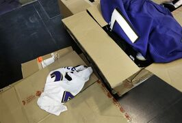 Former Baltimore Ravens running back Ray Rice jerseys that fans traded in sit strewn atop cardboard boxes, Friday, Sept. 19, 2014, at M&T Bank Stadium in Baltimore. The Ravens offered fans a chance to exchange their Rice jerseys for those of another player after he was cut by the team and suspended indefinitely by the NFL for domestic violence. (AP Photo/Patrick Semansky)