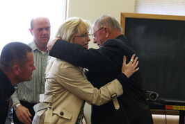 Henry Rayhons hugs members of his family after being found not guilty of sexual abuse at the Hancock County Courthouse in Garner, Iowa, on Wednesday.