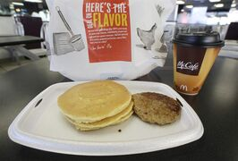 FILE - In this Feb. 14, 2013 file photo, a McDonald's breakfast is arranged for an illustration at a McDonald's restaurant in New York. After decades of complaints from customers that breakfast wasn't available past 10:30 a.m., McDonald's is testing an all-day breakfast menu in San Diego. If successful, it's just one way the company could boost customer traffic. (AP Photo/Mark Lennihan)