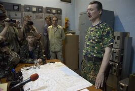 Igor Strelkov, a pro-Russian rebel commander speaks to the media in the city of Donetsk, eastern Ukraine Monday, July 28, 2014. Igor Strelkov held a briefing about a military situation in the Donetsk region on Monday evening. (AP Photo/Dmitry Lovetsky)