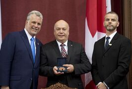 Quebec Liberal MLA Robert Poeti, flanked by Quebec Premier designate Philippe Couillard, left, and secretary general Michel Bonsaint, after he was sworn in, Thursday, April 17, 2014 at the legislature in Quebec City. Poeti told reporters he wanted Radio Canada to reveal the name of the supposed Liberal MLA named in a corruption inquiry (UPAC). THE CANADIAN PRESS/Jacques Boissinot