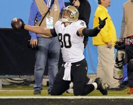 New Orleans Saints' Jimmy Graham (80) reacts after catching a touchdown pass against the Carolina Panthers in the first half of an NFL football game in Charlotte, N.C., Thursday, Oct. 30, 2014. (AP Photo/Mike McCarn)
