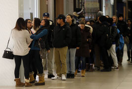 Hundreds of people lined up outside H&M at Polo Park Friday before the store opened at 7 a.m. for Black Friday.