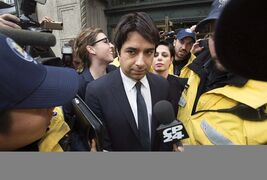 Jian Ghomeshi is escorted by police out of court past members of the media in Toronto on Wednesday, November 26, 2014. A book on the disgraced former radio star, written by Toronto Star investigative reporter Kevin Donovan, is slated for release in late June. THE CANADIAN PRESS/Darren Calabrese