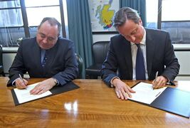 FILE - This is a Monday, Oct. 15, 2012 file photo of Britain's Prime Minister David Cameron, right, and Scotland's First Minister Alex Salmond, sign a referendum agreement during a meeting at St Andrews House in Edinburgh. The agreement between Salmond's SNP and Prime Minister David Cameron's Conservative-led British government paves the way for a referendum. The referendum will held on Thursday Sept. 18, 2014. (AP Photo/Gordon Terris, Pool, File)