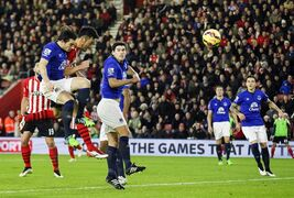Southampton's Maya Yoshida, second left, beats Everton's Leighton Baines to score past Everton's Tim Howard, during their English Premier League match at St. Mary's Stadium, Southampton, England, Saturday Dec. 20, 2014. (AP Photo/PA, Chris Ison) UNITED KINGDOM OUT NO SALES NO ARCHIVE