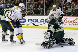 Nashville Predators center Craig Smith (15) scores on Minnesota Wild goalie Ilya Bryzgalov (30), of Russia, during the second period of an NHL hockey game in St. Paul, Minn., Sunday, April 13, 2014. (AP Photo/Ann Heisenfelt)