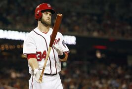 Washington Nationals' Bryce Harper tosses his bat after striking out during the seventh inning of a baseball game against the Philadelphia Phillies at Nationals Park Thursday, July 31, 2014, in Washington. The Phillies won 10-4. (AP Photo/Alex Brandon)