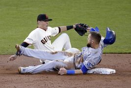 FILE - In this Oct. 25, 2014, file photo, Kansas City Royals' Alex Gordon steals second as San Francisco Giants' Joe Panik misses the ball during the third inning in Game 4 of baseball's World Series in San Francisco. The Royals grinded out runs one at a time. They stole bases, went first to third on infield hits, scrapped for the lead. (AP Photo/Charlie Riedel, FIle)