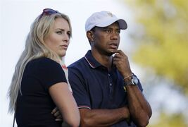FILE - This Oct. 3, 2013 file photo shows Tiger Woods watching with his girlfriend Lindsey Vonn at the Presidents Cup golf tournament at Muirfield Village Golf Club in Dublin, Ohio. Vonn announced on Sunday, May 3, 2015, that she and Woods have decided to end their three-year relationship. (AP Photo/Darron Cummings, file)