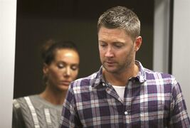 "Australia cricket captain Michael Clarke, right, and his wife, Kyly, arrive to a media briefing following the death of fellow cricketer Phillip Hughes during a press conference at St. Vincent's Hospital in Sydney, Thursday, Nov. 27, 2014. Hughes, 25, died in the hospital from a ""catastrophic"" injury to his head Thursday, two days after being struck by a cricket ball during a domestic first-class match. (AP Photo/Rick Rycroft)"