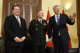 Lt.-Gen. Jonathan Vance, centre, poses for a photo in Ottawa on Monday, April 27, 2015 with Defence Minister Jason Kenney, left, and Prime Minister Stephen Harper after Vance was appointed the next chief of defence staff. THE CANADIAN PRESS/Adrian Wyld