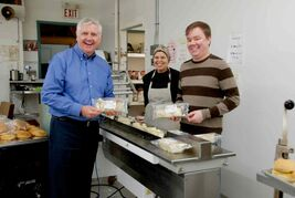 St. Johns MLA Gord Mackintosh (left) visits Rob Naleway (far right) and Joann Wolosaoski (centre) at Naleway Catering, likely home to the world record for its number of perogy varieties.