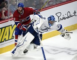 Montreal Canadiens winger Brandon Prust (8) runs into Tampa Bay Lightning goalie Ben Bishop (30) during third period of Game 2 NHL second round playoff hockey action Sunday, May 3, 2015 in Montreal.THE CANADIAN PRESS/Ryan Remiorz
