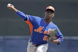 New York Mets starting pitcher Rafael Montero delivers a warmup pitch before the start of an exhibition baseball game against the New York Yankees in Tampa, Fla., Wednesday, March 25, 2015. (AP Photo/Kathy Willens)