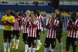 PSV's players applaud to supporters at the end of the Europa League group E soccer match between PSV Eindhoven and Estoril at the Antonio Coimbra da Mota stadium in Estoril, Portugal, Friday, Nov. 28, 2014. The match that resumed Friday after being suspended on Thursday due to the heavy rain ended in a 3-3 draw. (AP Photo/Francisco Seco)