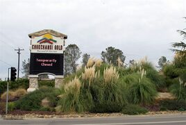 In this photo taken Thursday, Nov. 20, 2014, a sign at the main entrance to the shuttered Chukchansi Gold Resort and Casino in Coarsegold, Calif., reads