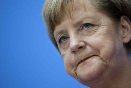 Chancellor and chairwoman of the German Christian Democrats, Angela Merkel, attends a press conference in Berlin, Germany, Monday, Sept. 15, 2014, the day after the elections in the German states of Thuringia and Brandenburg.