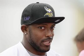 This July 28, 2014 photo shows Minnesota Vikings cornerback Captain Munnerlyn speaking to the media after an NFL football training camp practice in Mankato, Minn. Munnerlyn started his first Minnesota Vikings training camp on the sideline, working his way through a minor hamstring injury on the physically unable to perform list. (AP Photo/Charlie Neibergall)