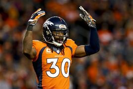 FILE - In this Dec. 7, 2014, file photo, Denver Broncos strong safety David Bruton celebrates during the second half of an NFL football game against the Buffalo Bills in Denver. Bruton aims to earn a starting job in 2015 for the first time since his senior season at Notre Dame in 2008.