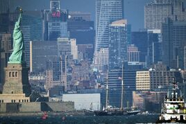 The 120-foot-tall schooner, Clipper City, center, rests stranded near the Statue of Liberty after running aground and getting stuck in shallow water in New York, Saturday, Sept. 20, 2014. No injuries were reported and the 121 tourists on board were ferried in small boats to a lower Manhattan marina. (AP Photo/The Advance, Bill Lyons) MANDATORY CREDIT; TV OUT; NO SALES, NYC OUT