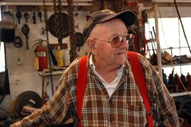 In this April 24, 2013 photo, retired logger Jim Ford stands in his shop in Grants Pass, Ore. While Ford thinks logging can still be a major part of the economy in the rural West, jobs are half what they were 20 years ago, and mills continue to close. The region continues to look for new sources of jobs and government revenues. (AP Photo/Jeff Barnard)
