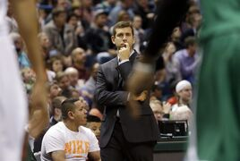 Boston Celtics head coach Brad Stevens watches during the first half of an NBA basketball game against the Milwaukee Bucks Wednesday, April 15, 2015, in Milwaukee. (AP Photo/Morry Gash)