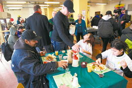 Fundraising efforts help Siloam Mission serve more than 300,000 meals a year, such as this one last Christmas Eve.
