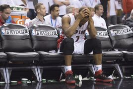 Toronto Raptors' Kyle Lowry sits on the bench after fouling out of the game during fourth quarter NBA playoff action against the Washington Wizards in Toronto on Saturday, April 18, 2015. THE CANADIAN PRESS/Frank Gunn
