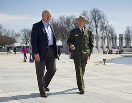 In this Monday, March 23, 2015 photo, National Park Service Director Jonathan Jarvis, right, and the head of the National Park Foundation Dan Wenk walk at the World War II Memorial on the National Mall in Washington. With its centennial approaching in 2016, the park service will launch a major campaign Thursday, April 2 in New York City to raise support and introduce a new, more diverse generation of millennials and children to
