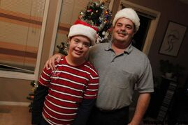 Ken Hodges and his son, Braden, whose family joined the Manitoba Down Syndrome Society about 13 years ago after Braden's birth.