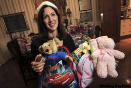 Birthday Buddies founder Jennifer Fast shows some of the toys in her birthday backpacks.