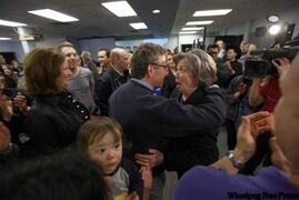 Joyce Bateman gives David Asper a hug and surprised look after her win.