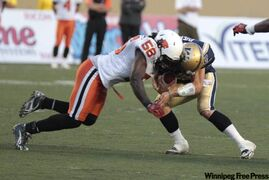 Lions Solomon Elimimian collides with Bombers Buck Pierce in the second half.