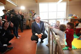 Premier Greg Selinger visits Morrow Avenue Child Care in 2013. The province is considering the idea of raising child-care fees to match the UCCB hike.