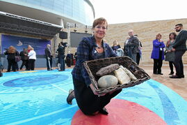 Gail Asper holds a basket of stones from the four corners of Canada — and one from Lower Fort Garry —  following  Friday's opening  ceremony.