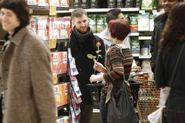 A couple chats at singles night at the Osborne Village Safeway last night.