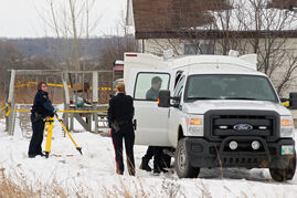 RCMP major crimes officers and Dakota Ojibway Police Service officers work at the scene of two fatalities at a home at Sioux Valley Dakota Nation on Friday evening.