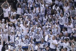 Fans cheer in the third period in the third game of the Stanley Cup playoff series between the Winnipeg Jets and the Anaheim Ducks at MTS Centre in Winnipeg, Manitoba.