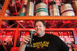Barley Brothers president and co-founder Noel Bernier drinking a beer. Beer is still the king of booze in Manitoba. It is also the fastest growing category of booze in terms of sales growth, in large part because of the runaway popularity of craft beers. This location of Barley Brothers on Pembina Highway has 156 different types of craft beer on tap in a two-story-high cooler.