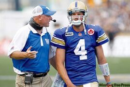 Bomber coach Paul LaPolice consults QB Buck Pierce Friday. The coach's best days may lie ahead.