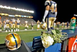 A white rose was placed on the Blue Bombers'  bench to remember their fallen coach Richard Harris on Thursday.