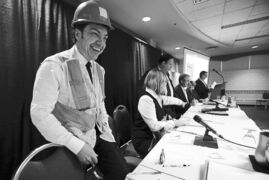 Michel Fillion wore a safety vest and hard hat to an CAA infrastructure debate.