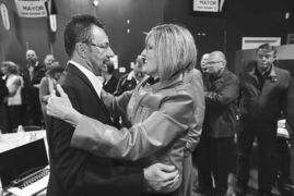 Brandon mayor-elect Rick Chrest is congratulated by defeated mayor Shari Decter Hirst Wednesday evening in Brandon.