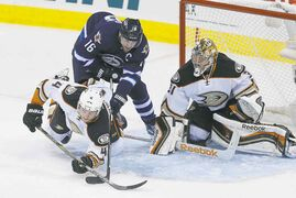 Winnipeg Jets� Andrew Ladd (16)�� and Anaheim Ducks� Cam Fowler (4) fight for position in front of Ducks goaltender Frederik Andersen (31) during first period NHL game 3 playoff action in Winnipeg on Monday, April 20, 2015. John Woods/Winnipeg Free Press