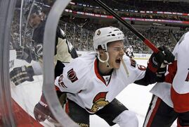 Ottawa Senators defenseman Erik Karlsson (65) grimaces as he falls to the ice after colliding with Pittsburgh Penguins left wing Matt Cooke, left, during the second period of a game in Pittsburgh Wednesday, Feb. 13, 2013.